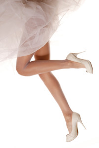 Bridal flying legs in high heels on white background